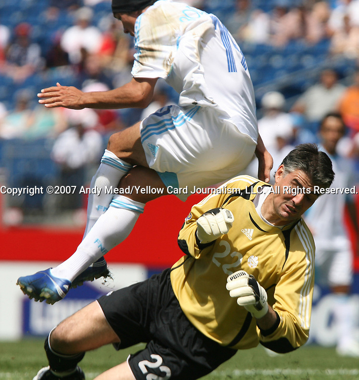 16 June 2007: Canada's Patrick Onstad (22) and Guatemala's Mario Rodriguez (19) collide. The Canada Men's National team defeated the Guatemala Men's National Team 3-0 at Gillette Stadium in Foxboro, Massachusetts in a 2007 CONCACAF Gold Cup quarterfinal.