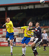 Greenock Morton's Martin Hardie heads clear as team mate Kevin Rutkiewicz and Dundee's Colin Nish  watch - Dundee v Greenock Morton, William Hill Scottish Cup 5th Round at Dens Park .. - © David Young - www.davidyoungphoto.co.uk - email: davidyoungphoto@gmail.com