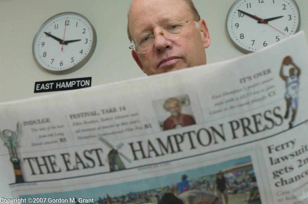 Southampton, NY - 4/4/07 -  Peter Boody, editor of the East Hampton Press, with a mockup of the new paper, at his offices in Southampton, NY April 4, 2007.    (Photo by Gordon M. Grant)