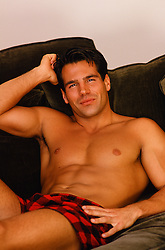 sexy shirtless man at home on a couch