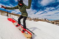 Snowboarding, Snowmass Terrain Park, Snowmass (Aspen) ski resort, Colorado USA.