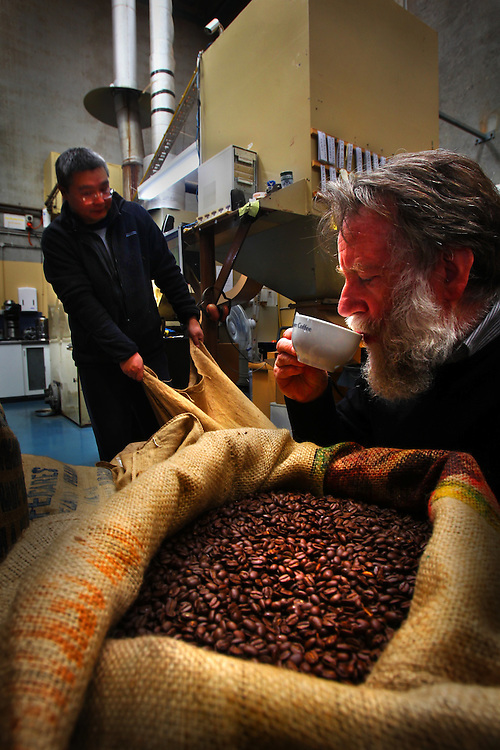 Coffee prices are on the rise, Wells Trenfield is tasting coffee at Jasper's coffee, while Tong Zhou works the coffee roaster - Pic By Craig Sillitoe 03/09/2010 melbourne photographers, commercial photographers, industrial photographers, corporate photographer, architectural photographers, This photograph can be used for non commercial uses with attribution. Credit: Craig Sillitoe Photography / http://www.csillitoe.com<br />
