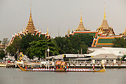 06 NOVEMBER 2012 - BANGKOK, THAILAND:  An Ekachai Hern How barge on the Chao Phraya River during the final dress rehearsal for the Royal Barge Procession. The Ekachai Hern How barges are basically tow barges. The tow the Royal Barge should it need extra help. Thailand's Royal Barge Procession has both religious and royal significance. The tradition is nearly 700 years old. The Royal Barge Procession takes place rarely, typically coinciding with only the most important cultural and religious events. During the reign of King Bhumibol Adulyadej, spanning over 60 years, the Procession has only occurred 16 times. The Royal Barge Procession consists of 52 barges: 51 historical Barges, and the Royal Barge, the Narai Song Suban, which King Rama IX built in 1994. It is the only Barge built during King Bhumibol's reign. These barges are manned by 2,082 oarsmen. The Procession proceeds down the Chao Phraya River, from the Wasukri Royal Landing Place in Bangkok, passes the Grand Palace complex and ends at Wat Arun. Tuesday's dress rehearsal was the final practice for the 2012 Royal Barge Procession, which takes place November 9.       PHOTO BY JACK KURTZ