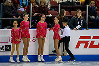 KELOWNA, BC - OCTOBER 25:  Skaters of the Kelowna Figure Skating club stand on the ice at Skate Canada International at Prospera Place on October 25, 2019 in Kelowna, Canada. (Photo by Marissa Baecker/Shoot the Breeze)