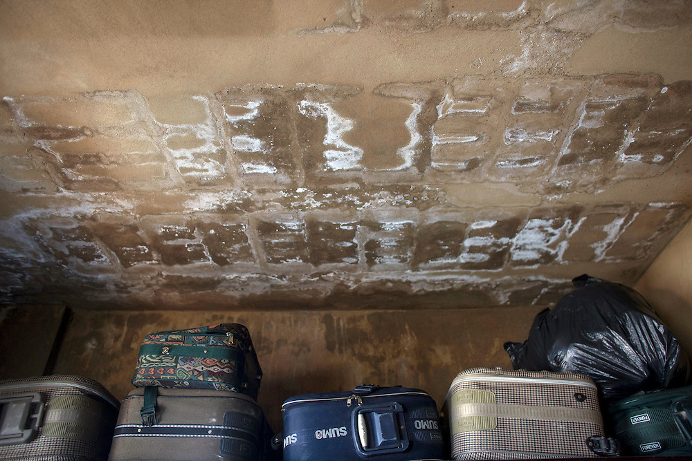 05/07/2013 near Damour, Lebanon: Suitcases belonging to refugees in  a two-bedroom apartment shared by 11 other people. Estimates have placed the number of Syrian refugees in Lebanon at well over 500,000 people.