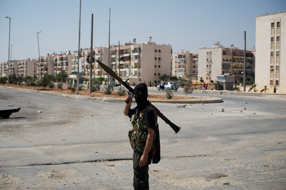 August 15, 2012 - Aleppo, Syria: A Free Syria Army (FSA) fighter takes guard at a rebel checkpoint near Circle of Jambul in northeast Aleppo. (Paulo Nunes dos Santos/Polaris)