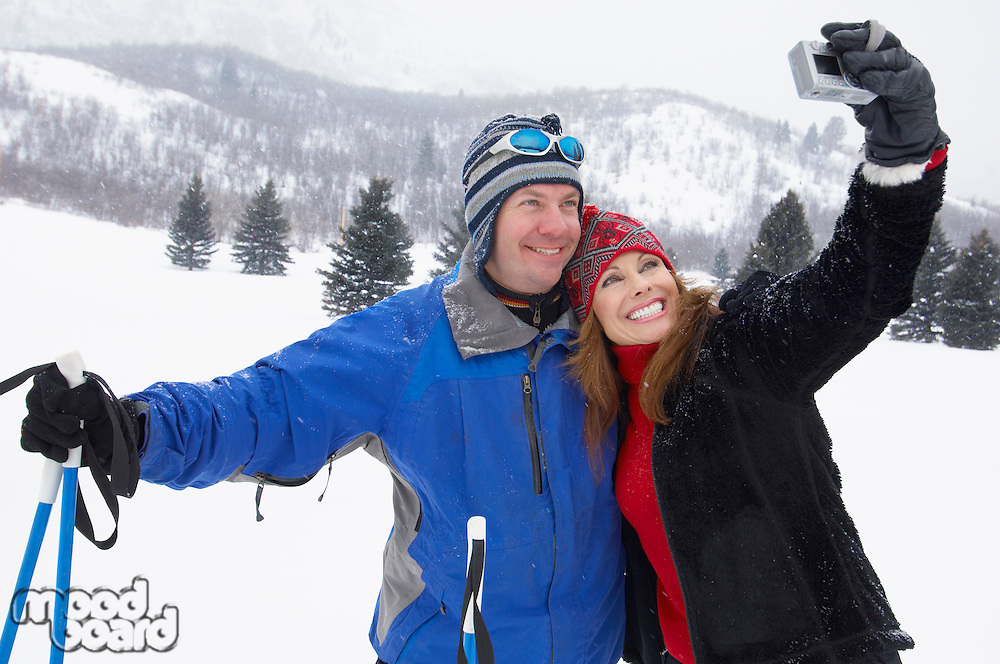 Skiing Couple Posing for Photo
