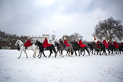 © Licensed to London News Pictures. 01/03/2018. London, UK. The Queen's Life Guard of the Household Cavalry Mounted Regiment cross a snow Horse Guards Parade in central London. The 'Beast from the East' and Storm Emma have brought extreme cold and heavy snow to the UK. Photo credit: Peter Macdiarmid/LNP