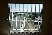 06 AUG 2014, BERLIN/GERMANY:<br /> Blick Richtung Spree aus einem vergitterten Fenster im 5 Stock, Haus 2, Abschiebungsgewahrsam der Berliner Polizei in Berlin-Koepenick, Gruenauer Strasse 140<br /> IMAGE: 20150806-01-016<br /> KEYWORDS: Köpenick, Abschiebungshaft, Abschiebeknast, Abschiebehaft, Polizeiabschiebehaftanstalt, Grünau; Gruenau