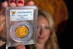 London, March13th 2015. Ahead of the first sale of the D. Brent Pogue rare United States Federal coin  collection sale to be held at Sotheby's  New York. The collection is composed of over 650 gold, silver, and copper coins, and is expected to be the most valuable collection of coins ever sold. PICTURED: An 1822 Five Dollar gold piece, the only example in private hands, which is anticipated to sell for up to US10 million at auction.