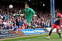 Photo: Leigh Quinnell.<br /> Luton Town v Southampton. Coca Cola Championship. 07/04/2007. Luton goalkeeper Dean Brill clears the ball from Southamptons  Jhon Viafara.