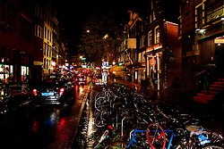 Amsterdam city street at night.