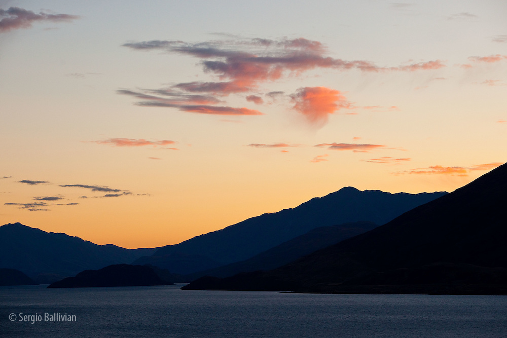 A colorful sunset on Lake Wanaka after a rainstorm in New Zealand's South Island.
