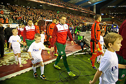 BRUSSELS, BELGIUM - Tuesday, October 15, 2013: Wales' Chris Gunter walks out to face Belgium before the 2014 FIFA World Cup Brazil Qualifying Group A match at the Koning Boudewijnstadion. (Pic by David Rawcliffe/Propaganda)