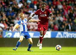 Divock Origi of Liverpool goes past David Perkins of Wigan Athletic - Mandatory by-line: Robbie Stephenson/JMP - 14/07/2017 - FOOTBALL - DW Stadium - Wigan, England - Wigan Athletic v Liverpool - Pre-season friendly