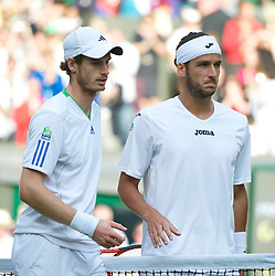 LONDON, ENGLAND - Wednesday, June 29, 2011: Andy Murray (GBR) and Feliciano Lopez (ESP) after the Gentlemen's Singles Quarter-Final match on day nine of the Wimbledon Lawn Tennis Championships at the All England Lawn Tennis and Croquet Club. (Pic by David Rawcliffe/Propaganda)