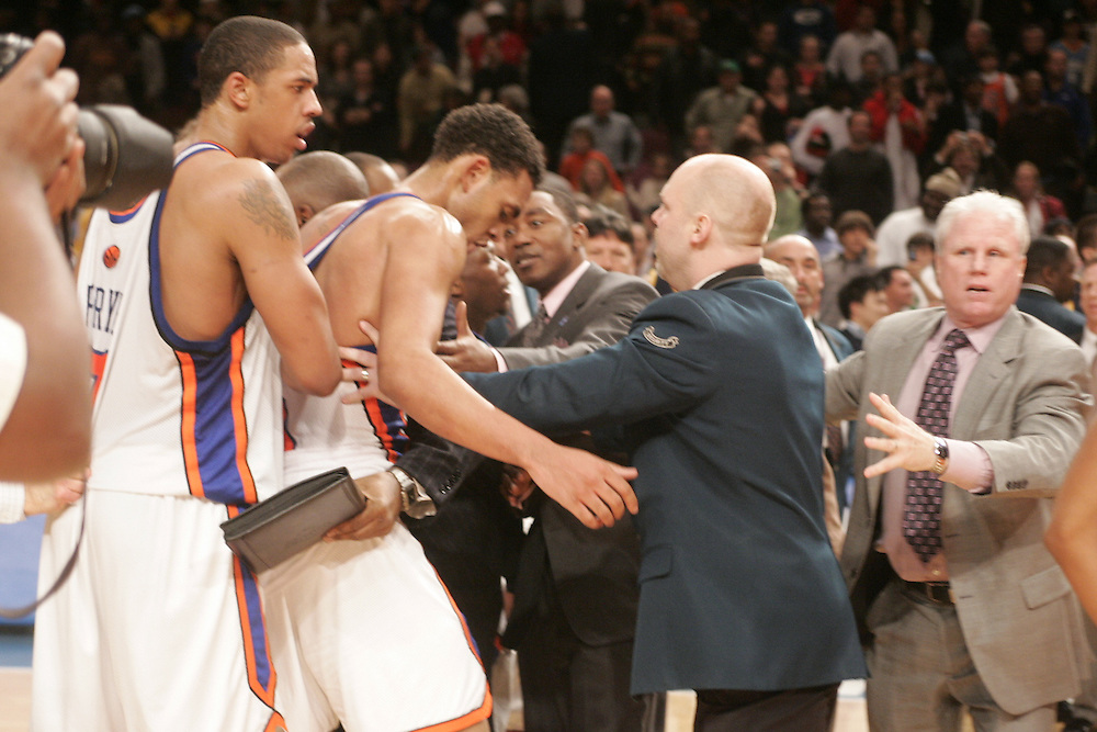 Jared Jeffries of the New York Knicks is restrained by teammates and security during a fight with members of the Denver Nuggets at Madison Square Garden, New York on Saturday  16 December 2006. (Andrew Gombert for The New York TImes)