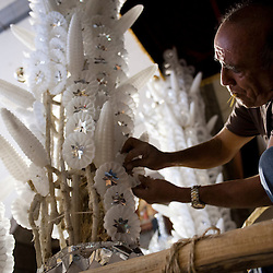 Pedro Alarcon builds a religious float using traditional wax ornaments in Ayacucho, Peru during Holy Week.<br /> The Alarcon family has been building religious floats for the Holy Week processions in Ayacucho for five generations.