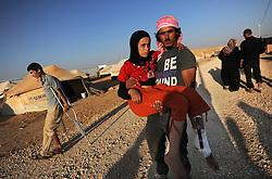 Syrian refugees at the Zaatari refugee camp in Jordan. Girl shot during fighting, September 3, 2012. Photo by Nick Cornish/i-Images.