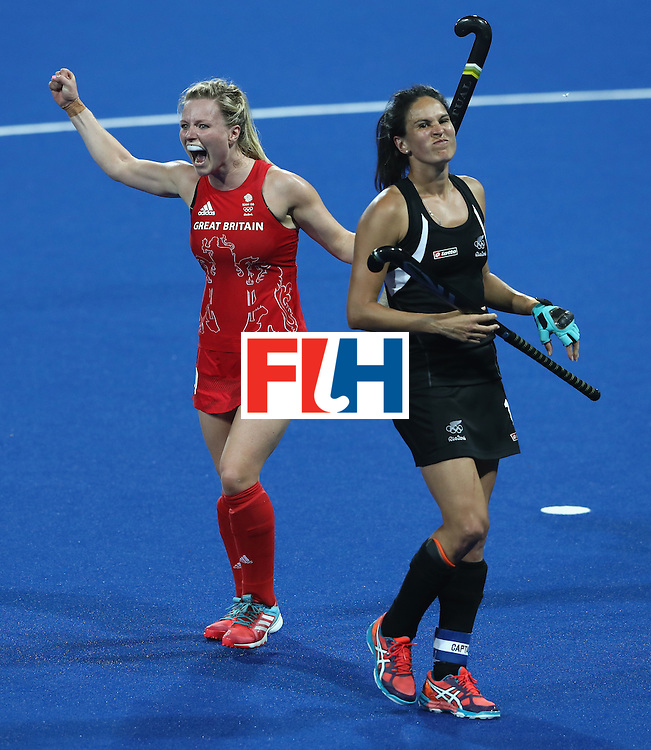 RIO DE JANEIRO, BRAZIL - AUGUST 17:  Hollie Webb (L) of Great Britain celebrates as Kayla Whitelock looks dejected after Great Britain's 3-0 victory during the Women's hockey semi final match betwen New Zealand and Great Britain on Day12 of the Rio 2016 Olympic Games at the Olympic Hockey Centre on August 17, 2016 in Rio de Janeiro, Brazil.  (Photo by David Rogers/Getty Images)