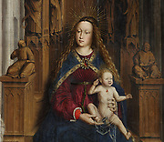 Mare de Deu dels Consellers, or Virgin of the Councillors, detail, 1445, oil painting on wood by Lluis Dalmau, 1428-61, in Gothic style, in the Museu Nacional d'Art de Catalunya, Barcelona, Spain. The Virgin has loose hair and a blue cloak fastened with a jewel and the Christ child is partly covered with a veil. The painting depicts a life-size Virgin and Child seated on a Gothic throne, flanked by St Andrew and St Eulalia (patron saint of Barcelona) with their martyrdom attributes and the 5 councillors of the city of Barcelona who commissioned the altarpiece (Joan Llull, Francesc Llobet, Joan Junyent, Ramon Savall and Antoni de Vilatorta). This altarpiece originally came from the Capella de la Casa de la Ciutat, Barcelona, Spain. Picture by Manuel Cohen