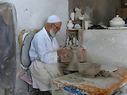 workshop makes a Tagine. A traditional Moroccan earthenware pot are sold in the markets around Morocco