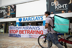 © Licensed to London News Pictures. 15/06/2020. Manchester, UK. A protest against cuts made by British Airways , outside Barclays Bank on Market Street in Manchester City Centre . High street shops reopen in Manchester City Centre for the first time since measures forced non-essential retailers to close , in order to limit the spread of the Coronavirus . Photo credit: Joel Goodman/LNP