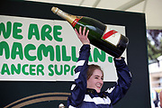 Miss Sophie Dods celebrates winning The Queen Mothers Cup (for Lady Amateur Riders) over 1m 4f (£20,000) with her weight in champagne during the Macmillan Charity Raceday at York Racecourse, York, United Kingdom on 16 June 2018. Picture by Mick Atkins.