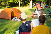 In camp, Biggar: the nightly meeting, getting the briefing on the next day's ride.
