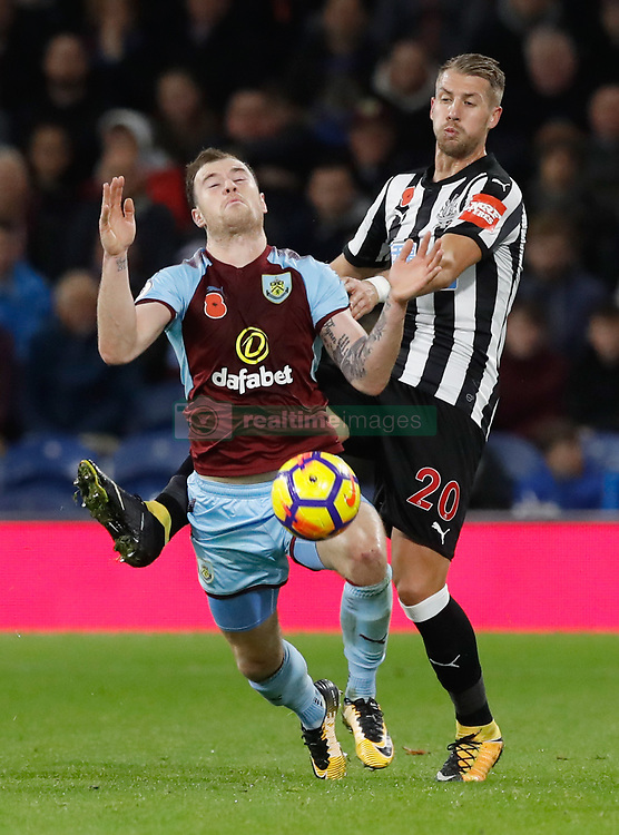 Burnley's Ashley Barnes (left) and Newcastle United's Florian Lejeune battle for the ball during the Premier League match at Turf Moor, Burnley.