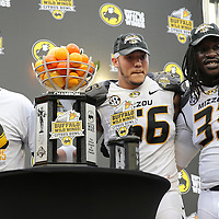 ORLANDO, FL - JANUARY 01:  Head coach Gary Pinkel, Shane Ray #56 and MVP Markus Golden #33 of the Missouri Tigers celebrate on the podium after winning the Buffalo Wild Wings Citrus Bowl between the Minnesota Golden Gophers and the Missouri Tigers at the Florida Citrus Bowl on January 1, 2015 in Orlando, Florida. (Photo by Alex Menendez/Getty Images) *** Local Caption *** Gary Pinkel; Markus Golden; Shane Ray