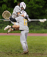 Warwick defender Joe Rice, left, celebrates with goalie Evan Florek after Warwick defeated Valley Central 12-4 in a Section 9 Class A semifinal game in Montgomery on Friday, May 24, 2013.
