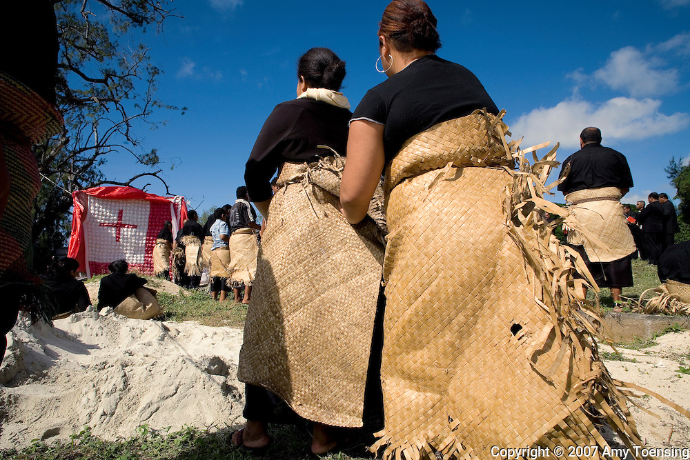 KOULO VILLAGE, TONGA - MARCH 30: Women following local custom and tradition, wear black and wrap themselves in mats woven with Pandanus leaves at a funeral on March 30, 2007 in Koulo Village, Tonga. Tonga is one of the last surviving monarchies in the south Pacific, however the people have recently risen up and called for the royal family to have less power and to move towards a more democratic government. (Photo by Amy Toensing/ Reportage by Getty Images) _________________________________<br />