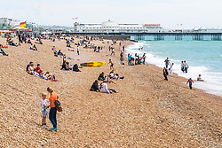 © Licensed to London News Pictures. 15/06/2019. Brighton, UK. Member of the public take to the beach in Brighton and Hove as milder and warm weather is hitting the seaside resort. Photo credit: Hugo Michiels/LNP