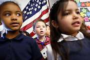 Kindergarteners Siani Reed, left, Eric Bata, center, and Sofia Cintra sing during the KLA-Tencor Computer Lab opening ceremony at Zanker Elementary School in Milpitas, California, on February 27, 2013. (Stan Olszewski/SOSKIphoto)