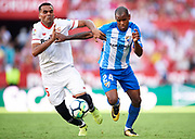 SEVILLE, SPAIN - SEPTEMBER 30:  Gabriel Mercado of Sevilla FC (L) competes for the ball with Diego Rolan of Malaga CF (R) during the La Liga match between Sevilla and Malaga at Estadio Ramon Sanchez Pizjuan on September 30, 2017 in Seville  (Photo by Aitor Alcalde Colomer/Getty Images)