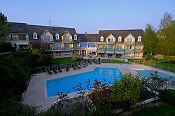 "NORMANDY, FRANCE - MAY-01-2007 - Omaha Beach Golf Club -  The swimming pool of the Mercure Hotel is the green of hole 9 of ""The Sea"" course. The 3 Star hotel has 70 guest rooms. (Photo © Jock Fistick)"