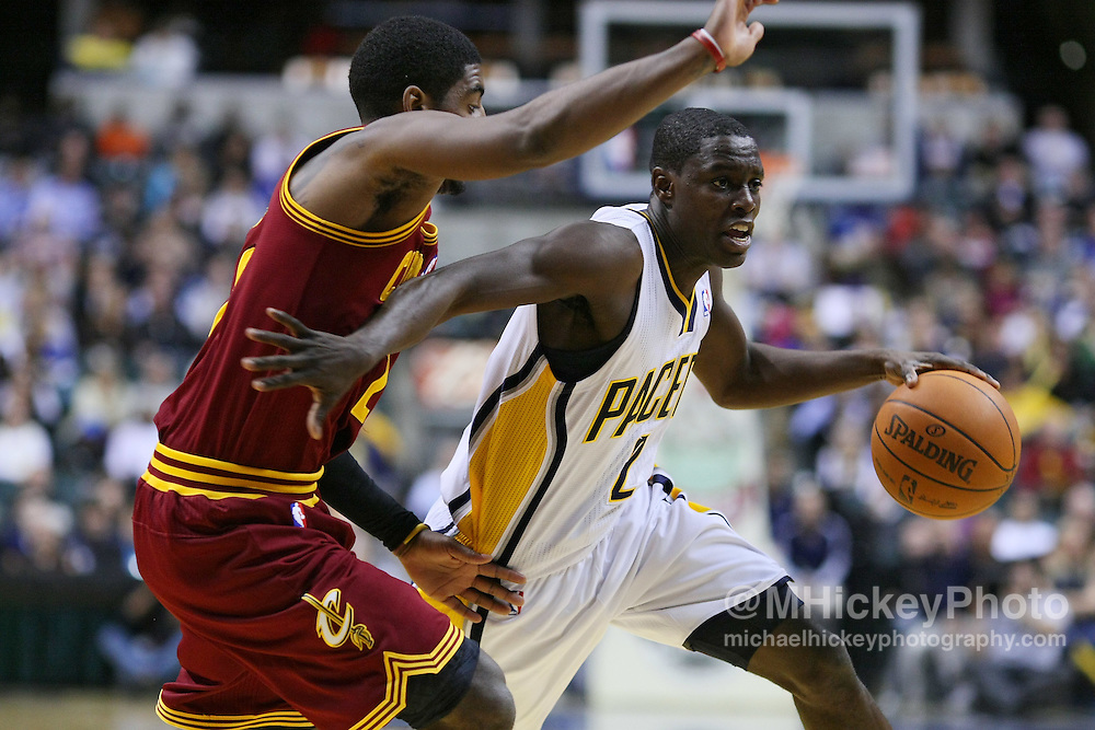 Dec. 30, 2011; Indianapolis, IN, USA; Indiana Pacers point guard Darren Collison (2) drbbles the ball as Cleveland Cavaliers guard Kyrie Irving (2) defends at Bankers Life Fieldshouse. Indiana defeated Cleveland 81-91. Mandatory credit: Michael Hickey-US PRESSWIRE