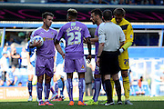 Simon Cox and Daniel Williams discuss who is taking the penalty during the Sky Bet Championship match between Birmingham City and Reading at St Andrews, Birmingham, England on 8 August 2015. Photo by Alan Franklin.