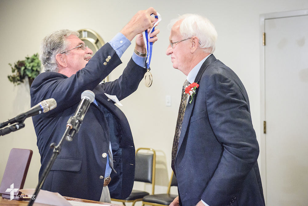 """The Rev. John Schumacher presents the """"Christus in Mundo (""""Christ in the World"""") award to the Rev. Dr. Melvin Jacobs at the SPM Zion XVI Conference award banquet on Saturday, Sept. 17, 2016, at the National Shrine of Our Lady of the Snows in Belleville, Ill. LCMS Communications/Erik M. Lunsford"""
