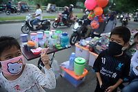 Medan, Indonesia, April 1, 2020: The daily life of a resident which using mask to avoid the spread of Corona Virus Disease-19 in Medan, North Sumatra province, Indonesia on April 1, 2020.