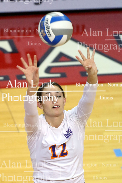 06 November 2010: Kaisi Nixon sets across the court during an NCAA volleyball match between the Purple Aces of the University of Evansville and the Illinois State Redbirds at Redbird Arena in Normal Illinois.