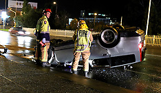 Auckland-Car rolls on Great North Road, Henderson