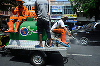 04-06-2020   Medan, Indonesia: Indonesian government officers seen while disinfecting the public roads as daily schedule to tackle the Corona Virus Disease 19  outbreak in Medan, North Sumatra province, Indonesia on April 6, 2020. More than 1,2 million people on in the worlds were struck by COVID-19 spread as the deadly characteristics virus and 69,485 known dead as the online data of World Health Organization (WHO) from Worldometer.