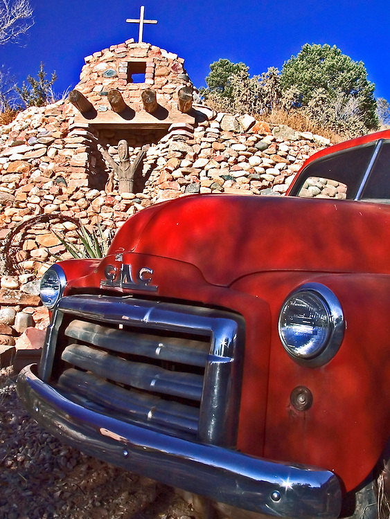 a vintage GMC car parked in Santa Fe, New Mexico, shrine in the background