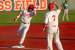 NORMAL, IL - April 08: John Rave rounds 3rd and gets a high five from the coach after hitting a 2 run homer to put the 'birds in the lead during a college baseball game between the ISU Redbirds  and the Sacramento State Hornets on April 08 2019 at Duffy Bass Field in Normal, IL. (Photo by Alan Look)