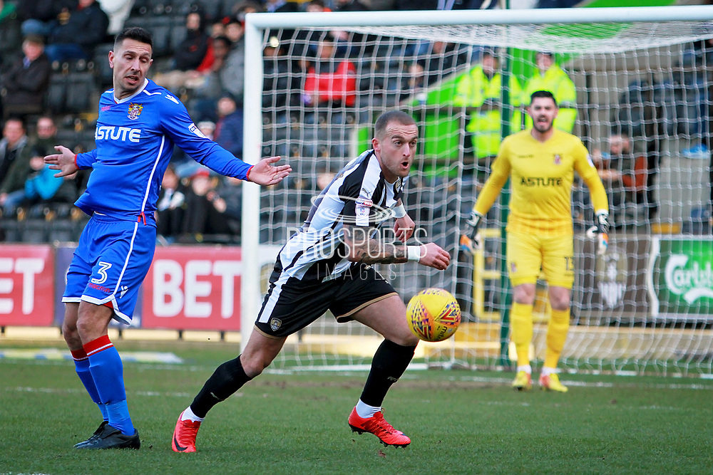 Notts County's Lewis Alessandra(7) stakes the ball away from Stevenage defender Joe Martin (3) during the EFL Sky Bet League 2 match between Notts County and Stevenage at Meadow Lane, Nottingham, England on 24 February 2018. Picture by Nigel Cole.