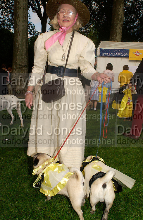 Tiggy and Mo with June Spicer, Macmillan dog day, in aid of Macmillan Cancer Relief, Chelsea , 6 July 2004. SUPPLIED FOR ONE-TIME USE ONLY-DO NOT ARCHIVE. © Copyright Photograph by Dafydd Jones 66 Stockwell Park Rd. London SW9 0DA Tel 020 7733 0108 www.dafjones.com