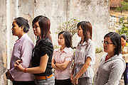08 APRIL 2012 - HANOI, VIETNAM:    Women pray outside the Cathedral during Easter Sunday mass in St. Joseph Cathedral in Hanoi, Vietnam. St. Joseph Cathedral in Hanoi is the seat of the Roman Catholic Archdiocese of Hanoi and is one of the most important Catholic churches in Vietnam. It was built in 1886 and is especially crowded on religious holidays, like Easter. The church holds three Easter masses on Easter Sunday morning. There are more than 5.6 million Roman Catholics in Vietnam, nearly 7% of the population. Catholicism came to what is now Vietnam with Portuguese missionaries in the 16th Century, but it wasn't until the arrival of French missionaries and later colonial authorities that Catholicism became a part of Vietnamese religious life.     PHOTO BY JACK KURTZ