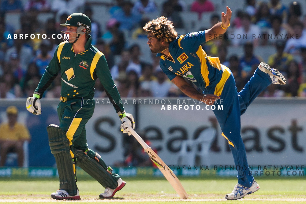 Lasith Malinga bowling as non striker Phil Hughes looks on during game 1 of the Commonwealth Bank Series Australia v Sri Lanka played at the Melbourne Cricket Ground in Melbourne,Victoria, Australia. Photo Asanka Brendon Ratnayake